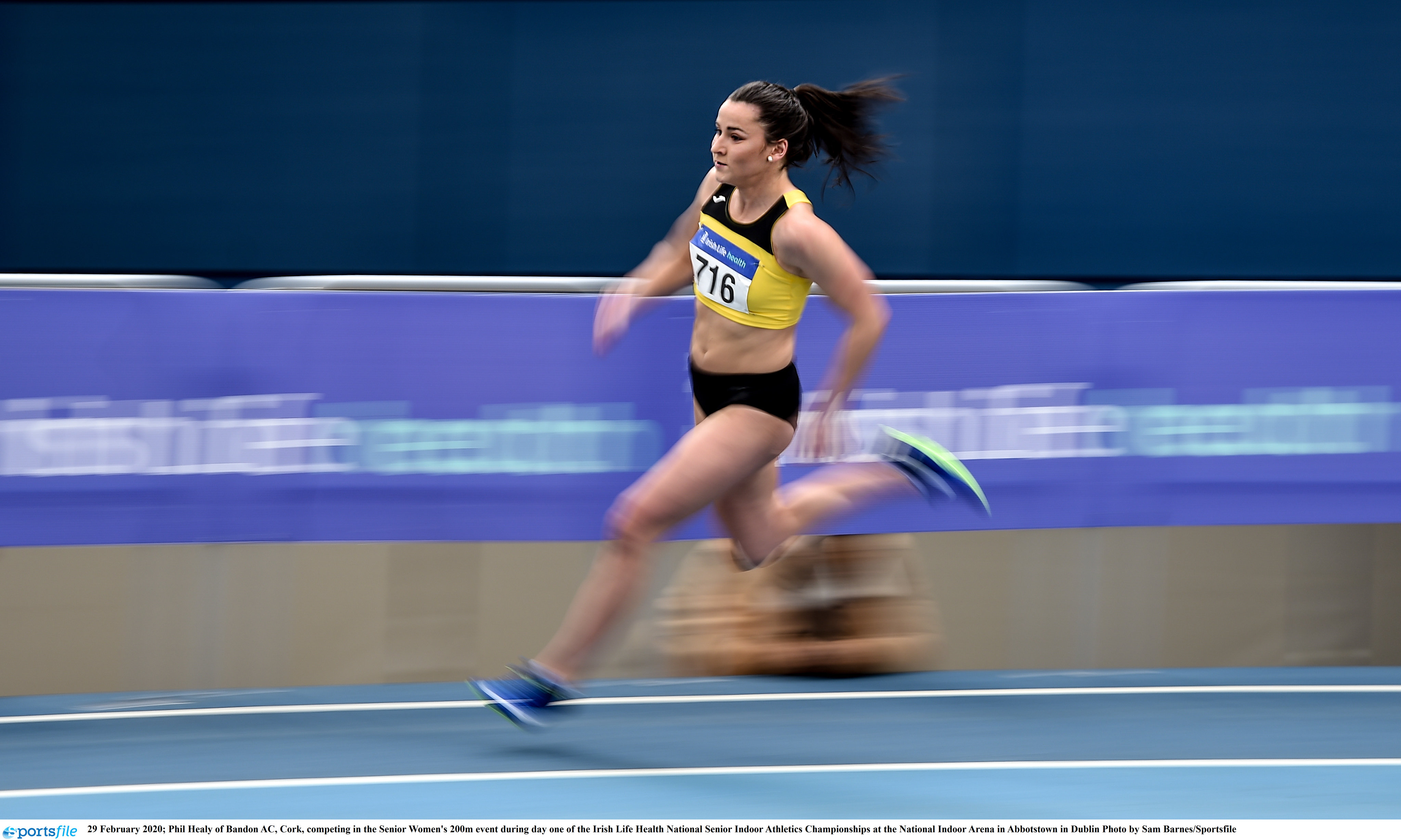 Healy whirs to 200m championship record on day 1